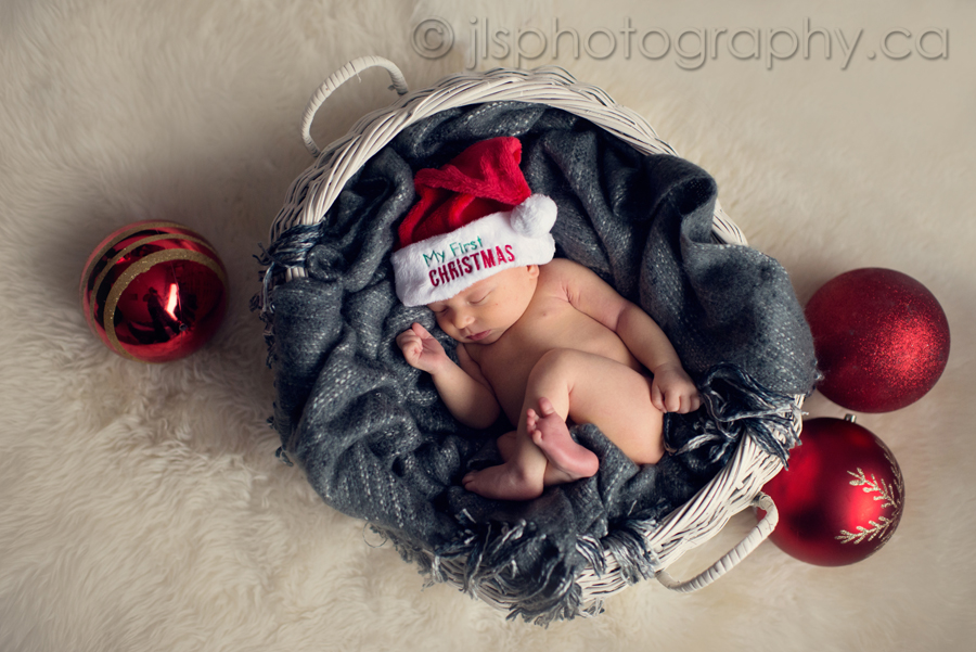 Christmas newborn photo, Newborn in basket, Newborn Santa hat, Newborn holiday photo, Newborn Christmas Photo, Best Newborn Photographer in Langley BC, Best Newborn Photographer White Rock BC, Newborn baby boy posed, JLS Photography,