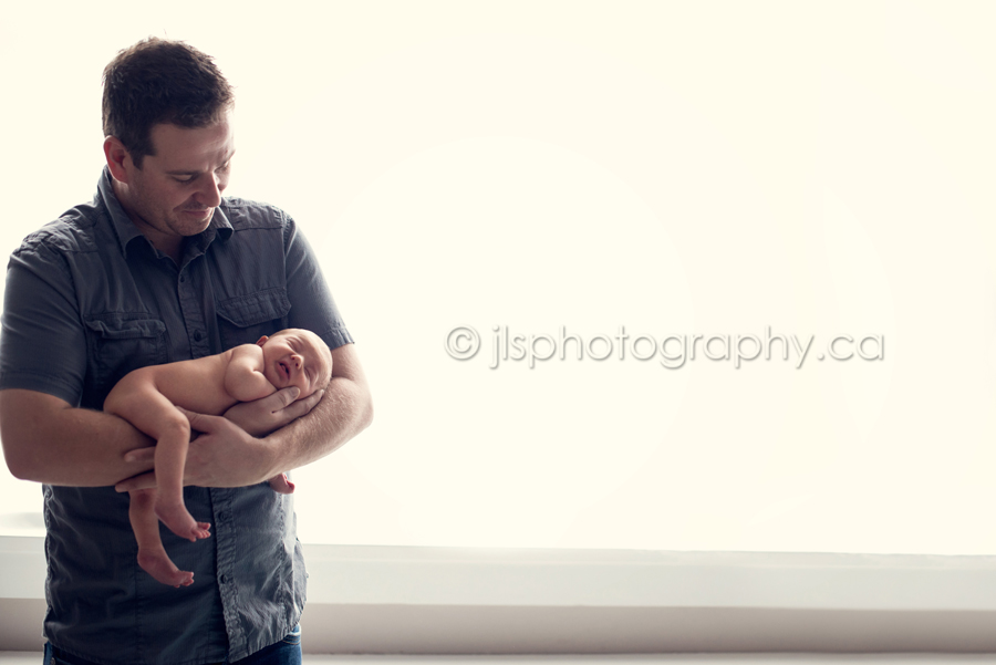 Newborn in daddy's arms, Baby boy and his Daddy, Daddy and his boy, Best Newborn Photographer in Langley BC, Best Newborn Photographer White Rock BC, Newborn baby boy posed, JLS Photography,