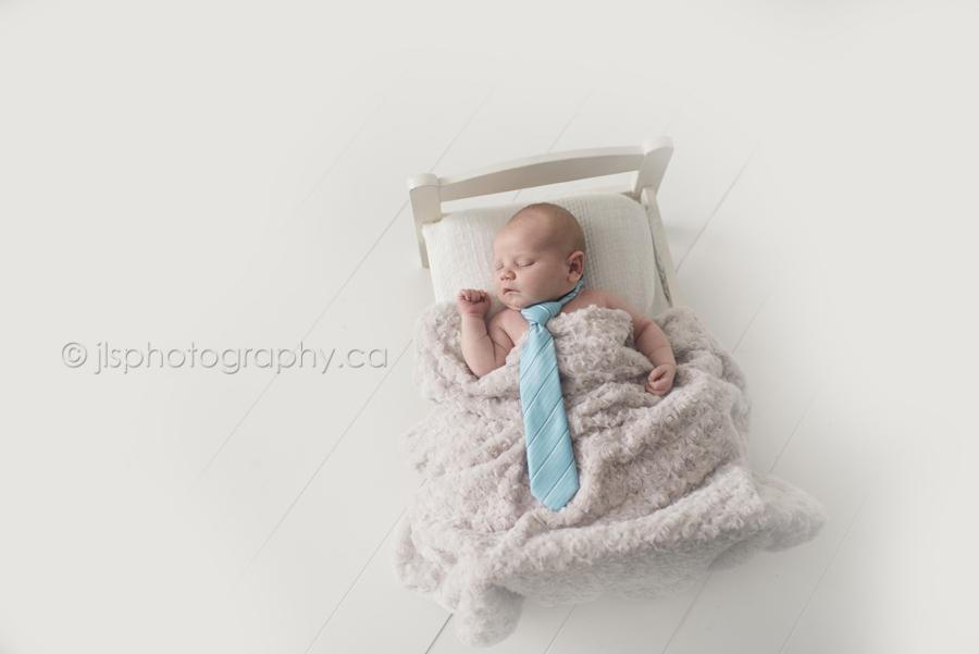 Newborn boy with a tie
