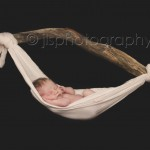 Newborn in a sling, newborn hanging, Newborn hanging with a stick, newborn suspended