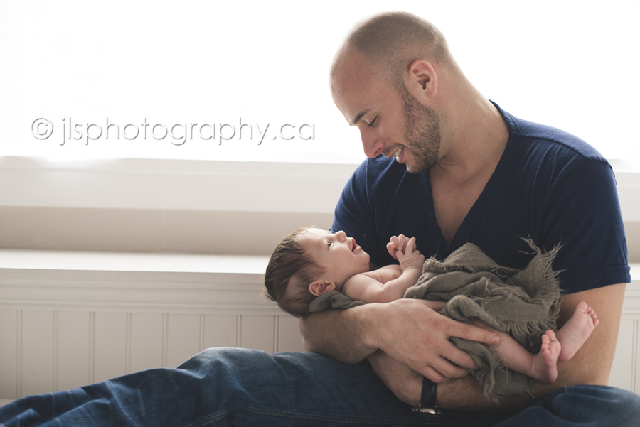 8 week old baby photos, talking to daddy, smiling at 8 weeks, love father son connection,