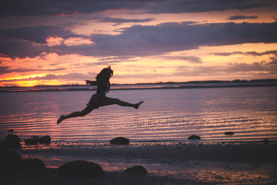 Ballet Dancer jumping, jumping into the sunset.