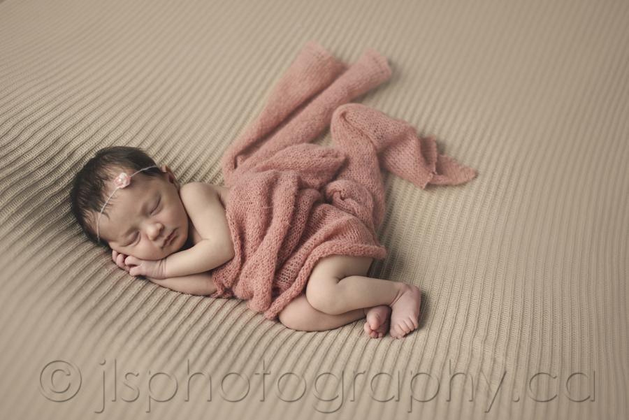 Newborn side pose, Newborn on a beanbag pose