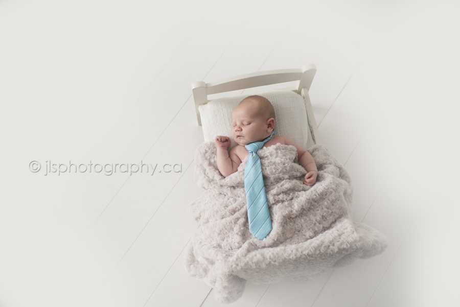 Newborn boy with a tie