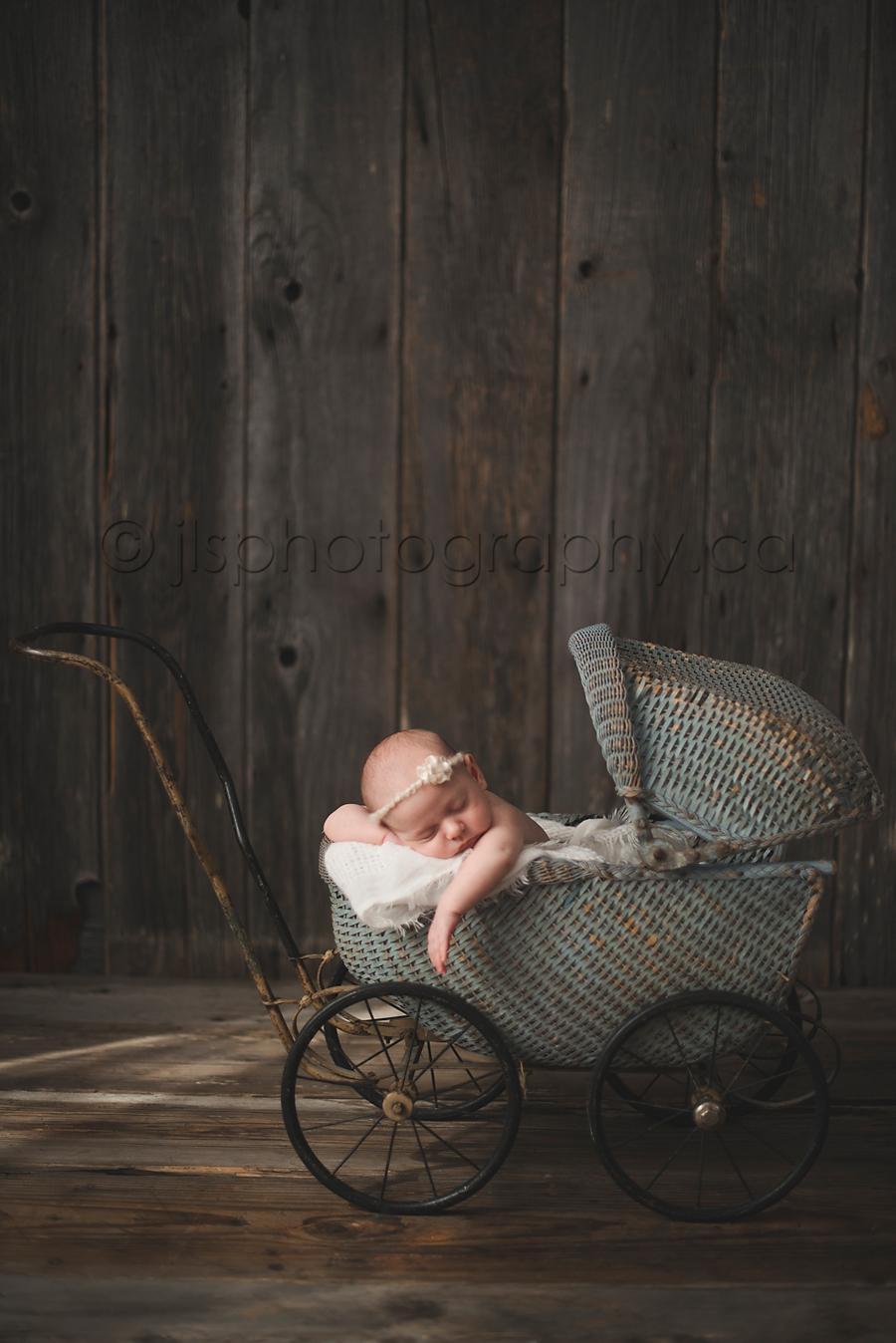Newborn sleeping in pram, newborn props