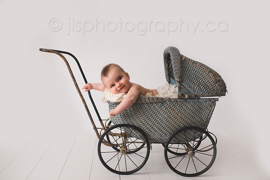 Baby in a buggy, Old fashioned pram